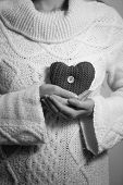Monochrome Photo Of Woman N Sweater Posing With Decorative Heart
