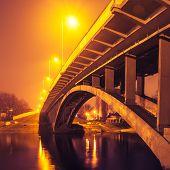 Illuminated bridge at night on the river Kiev