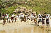 Fishermen Pulling A Fishing Net From The Arabian Sea