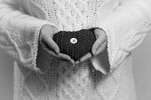Monochrome Photo Of Decorative Knitted Heart In Women Hands