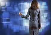 Rear view of businesswoman drawing on media screen