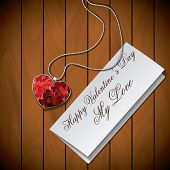 Letter With Pendant On Wood Background