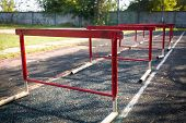 Old Red Hurdles For A Hurdle Race On Abandoned Stadium