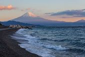Mountain Fuji and beach in early morning from Suruga bay , Shizuoka prefecture