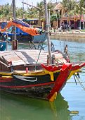 Постер, плакат: Fishing Boat In Hoi An Harbour Vietnam
