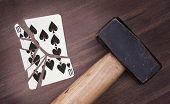 Hammer With A Broken Card, Ten Of Spades