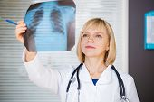 Portrait Of Confident Doctor Looking At Xray.