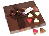 A box with chocolates and a ribbon