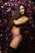 sexy woman  posing over flowers background