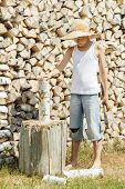 Teenage boy during wood chopping