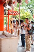 Tokyo,japan - May 25, 2014  Many People Donate Money And Benediction At Temple in Tokyo,japan