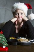 Unhappy Woman Having TV Dinner for Christmas