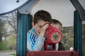 Spring On The Playground Boy Looking Through A Telescope.