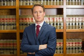 foto of frown  - Lawyer frowning in the law library at the university - JPG