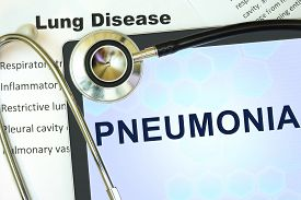 foto of pneumonia  - Tablet with word Pneumonia and stethoscope - JPG