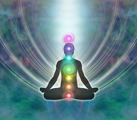 picture of divine  - Silhouette of a man in lotus meditation position with Seven Chakras on blue background with kundalini energy flowing downwards - JPG