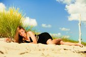 stock photo of sunbathing woman  - Summer vacation day freetime concept - JPG