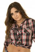 stock photo of cowgirl  - a cowgirl in her plaid top showing off her stomach - JPG