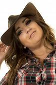image of cowgirl  - A cowgirl in her plaid top looking with a smile - JPG