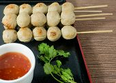 picture of meatball  - Food and Cuisine Grilled Meatballs on Wooden Skewer Served with Spicy Sauce and Green Coriander - JPG