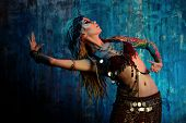 stock photo of belly-dance  - Art portrait of a beautiful traditional female dancer - JPG