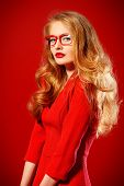 pic of wearing dress  - Beautiful young woman with magnificent blonde hair wearing red dress and elegant red glasses - JPG