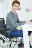 image of handicapped  - Handicapped teenager doing his homework - JPG