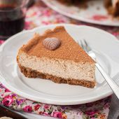 stock photo of cheesecake  - A Slice of Spiced Coffee Cheesecake Dusted with Cocoa Powder square - JPG