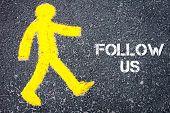 picture of pedestrians  - Yellow pedestrian figure on the road walking towards FOLLOW US - JPG