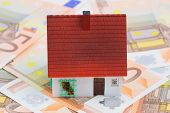 picture of plastic money  - Plastic house on Euro banknotes - JPG