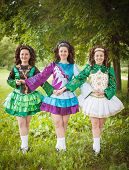 image of wig  - Three young beautiful girls in irish dance dress and wig posing outdoor - JPG