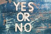 stock photo of yes  - Yes or no written with wooden letters on rustic wooden surface - JPG