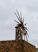 image of atlantic ocean  - Historic wooden wind mill in Valles de Ortega with twelve wings on the Spanish island Fuerteventura one of the Canary islands in the Atlantic Ocean belonging to Spain - JPG