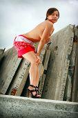 picture of topless  - Young sexy topless girl in red gown and high shoes - JPG