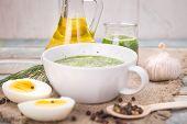 stock photo of pesto sauce  - sauce of pesto near a pepper olive oil and eggs in a studio  - JPG