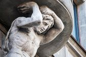 picture of atlas  - Sculpture of Atlas on the facade of the old building in Saint - JPG