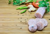 stock photo of fermentation  - Thai style fermented sausage called Neam on wood background with vegetable - JPG