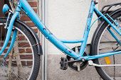 pic of lent  - Light Blue Bicycle lent against Brick Wall - JPG