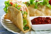 foto of tacos  - Tasty taco with tomato dip on plate on table close up - JPG