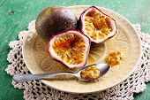 image of passion fruit  - Passion fruit on plate on color wooden background - JPG