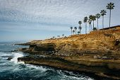 picture of cliffs  - Waves crashing on cliffs along the Pacific Ocean at Sunset Cliffs Natural Park Point Loma California - JPG