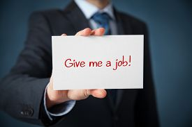 pic of unemployed people  - Young businessman hold paper card with text Give me a job - JPG