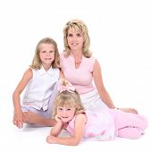 Beautiful Woman With Her Daughters Over White