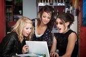 Surprised Girls Looking At A Laptop