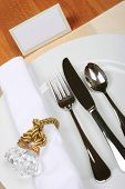 stock photo of tea party  - formal dinner service as at a wedding banquet with blank seating card - JPG