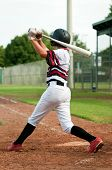 Постер, плакат: Youth Baseball Boy Swinging a Bat