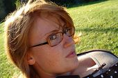 image of clevage  - a beautiful redhead with glasses in the sun - JPG