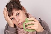 stock photo of hemorrhage  - this young beautiful woman drinks a cup of tea - JPG