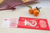 Постер, плакат: Red Chinese Envelope With Money On A Table