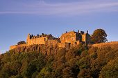 stock photo of braveheart  - Stirling Castle in Scotland basking in the soft glow of an autumn evening sunset - JPG